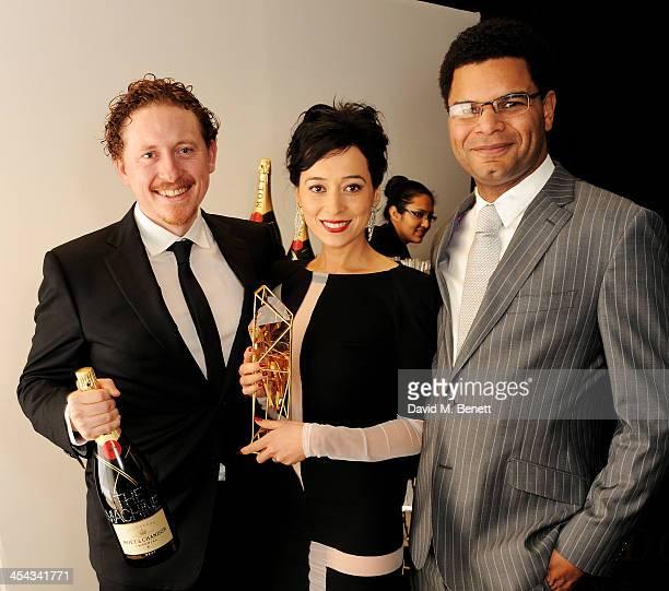 "Director Caradog W. James, actress Pooneh Hajimohammadi and producer John Giwa-Amu, winners of the Raindance Award for ""The Machine"" pose backstage..."