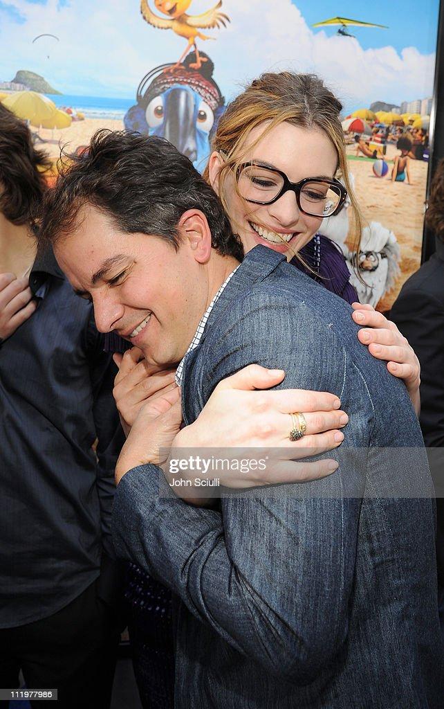 Director Carlos Saldanha and Anne Hathaway arrive for the premiere of Twentieth Century Fox & Blue Sky Studios' 'RIO' on April 10, 2011 in Hollywood, California.