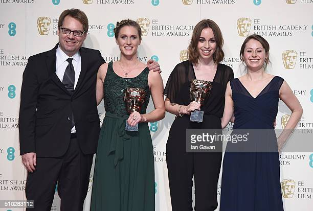 Director Caroline Bartleet and producer Rebecca Morgan and guests pose with their awards for a British short film for 'Operator' in the winners room...