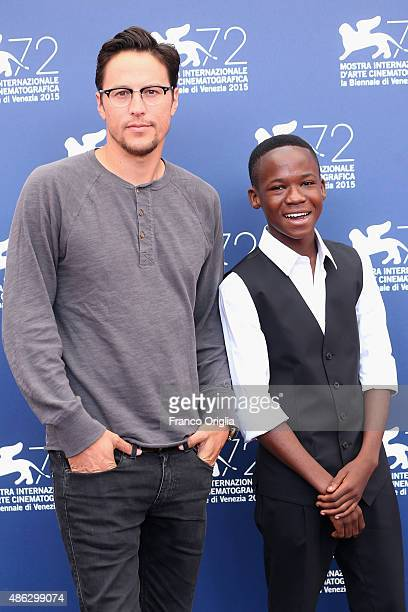 Director Cary Fukunaga and actor Abraham Attah attend a photocall for 'Beasts Of No Nation' during the 72nd Venice Film Festival at Palazzo del...