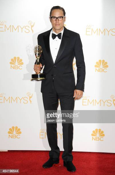 Director Cary Fukunaga poses in the press room at the 66th annual Primetime Emmy Awards at Nokia Theatre LA Live on August 25 2014 in Los Angeles...