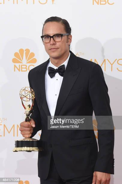Director Cary Joji Fukunaga winner of the Outstanding Directing for a Drama Series Award for True Detective poses in the press room during the 66th...