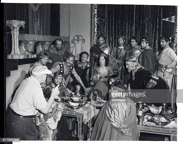 Director Cecil B DeMille gives instruction to the cast of his latest Biblical epic Samson and Delilah Hedy Lamarr plays Delilah To her right is Henry...