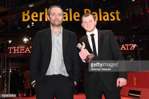 Director Cedric Kahn and Anthony Bajon winner of the Silver Bear for Best Actor for 'The Prayer' pose the award after the closing ceremony during the...