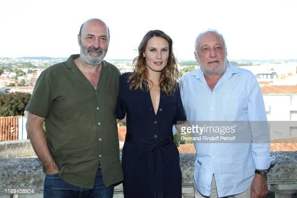 Director Cedric Klapisch actors Ana Girardot and Francois Berleand attend the Photocall of the movie Deux moi during the 12th Angouleme...