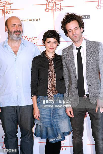 Director Cedric Klapish actress Audrey Tautou and actor Romain Duris attend screening of the movie 'Casse Tete Chinois' at Le Grand Rex on November...