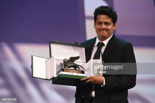 Director Chaitanya Tamhane poses onstage with the Lion of the Future 'Luidi de Laurentis' Venice award for a Debut Film for his movie 'Court' on...