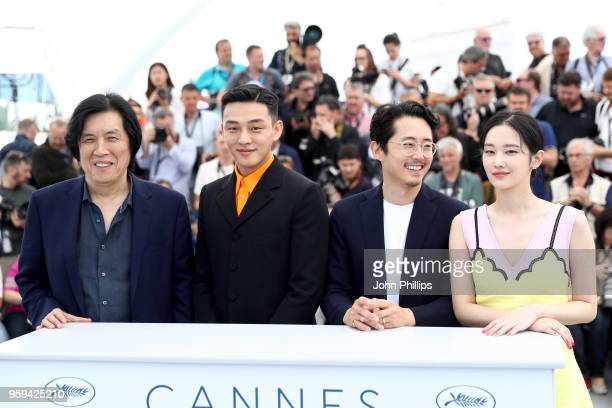 Director Changdong Lee Ahin Yoo Steven Yeun and actress Jongseo Jeon attend 'Burning' Photocall during the 71st annual Cannes Film Festival at Palais...