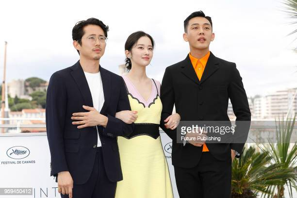 Director Changdong Lee Ahin Yoo Steven Yeun and actress Jongseo Jeon at the 'Burning' photocall during the 71st Cannes Film Festival at the Palais...