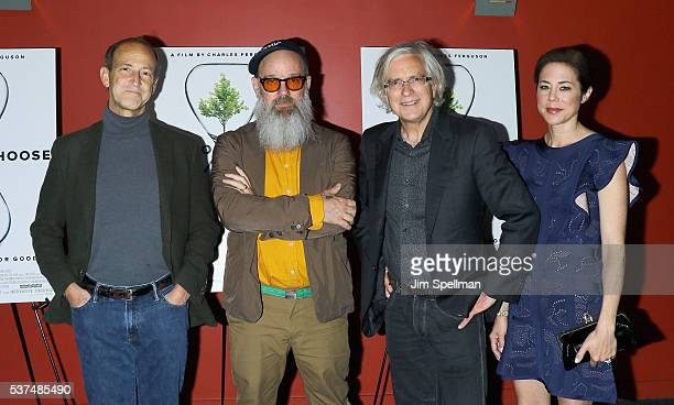 Director Charles Ferguson singer/songwriter Michael Stipe producers producers Tom Dinwoodie and Audrey Marrs attend the 'Time To Choose' New York...