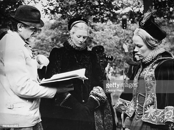 Director Charles Jarrott giving notes to actresses Vanessa Redgrave and Glenda Jackson, on the set of the film 'Mary Queen of Scots' at Shepperton...