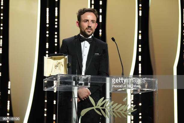 Director Charles William accepts the Palme d'Or Short Film award for 'All These Creatures' on stage during the Closing Ceremony at the 71st annual...