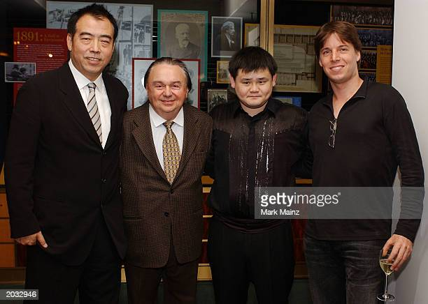 Director Chen Kaige David Franco violinist Chuanyun Li and Joshua Bell attend the after party for the premiere of 'Together' May 27 2002 at Carnegie...