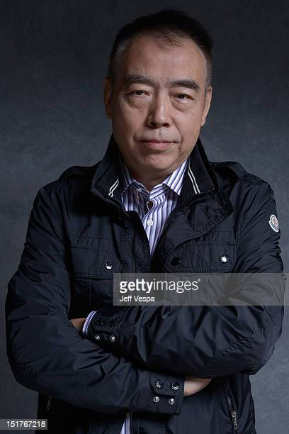 """Director Chen Kaige of """"Caught In The Web"""" poses at the Guess Portrait Studio during 2012 Toronto International Film Festival on September 11, 2012..."""