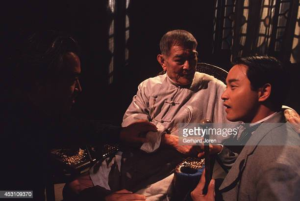Director Chen Kaige with Hong Kong actor Leslie Cheung Kwok Wing and Chinese actor Xie Tian during the filming of 'Temptress Moon' in Shanghai Film...