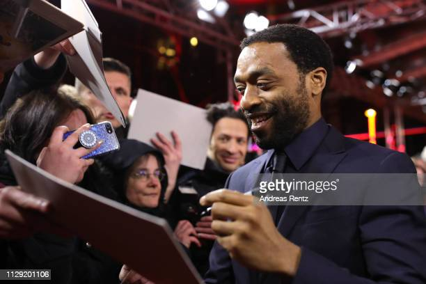 Director Chiwetel Ejiofor signs autographs for fans when arriving for the The Boy Who Harnessed The Wind premiere during the 69th Berlinale...