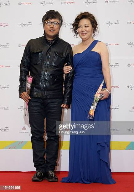Director Choi DongHoon and actress Kim HaeSook arrive for the 49th Daejong Film Awards at KBS Hall on October 30 2012 in Seoul South Korea