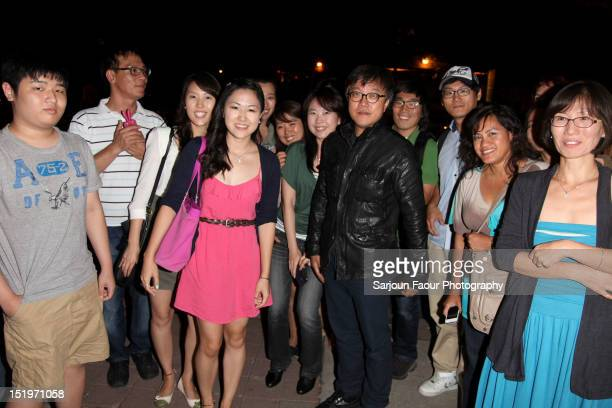 Director Choi Donghoon talks to his fans outside The Thieves premiere during the 2012 Toronto International Film Festival at the Ryerson Theatre on...