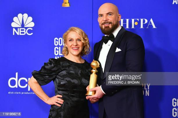 Director Chris Butler and producer Arianne Sutner pose in the press room with the award for Best Motion Picture Animated for Missing Link during the...