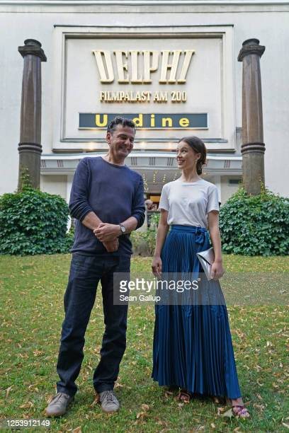 """Director Christian Petzold and actress Paula Beer attend the film """"Undine"""" at the Delphi movie theatre on the first day cinemas have been allowed to..."""