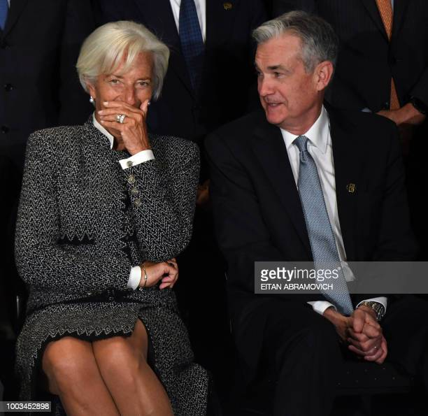 IMF Director Christine Lagarde speaks with US Chairman of the Federal Reserve Jerome Powell during the family picture of the G20 Finance Ministers...