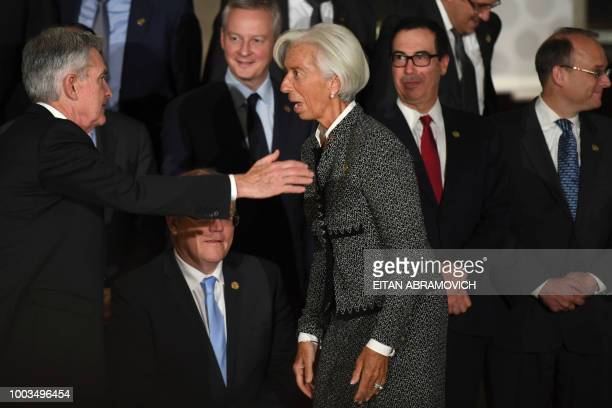 IMF Director Christine Lagarde speaks with US Chairman of the Federal Reserve Jerome Powell after the family picture of the G20 Finance Ministers and...