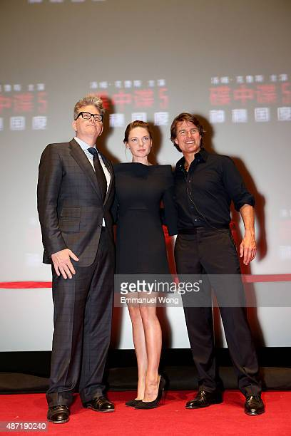Director Christopher McQuarrie Rebecca Ferguson and Tom Cruise attend the Beijing Fan Screening of Mission Impossible Rogue Nation at the on...