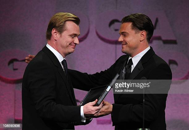 """Director Christopher Nolan accepts the Feature Film Nomination Plaque for """"Inception"""" from presenter Leonardo DiCaprio onstage at the 63rd Annual..."""