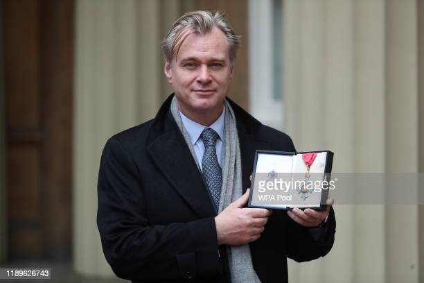 Director Christopher Nolan after he was made a Commander of the British Empire following an investiture ceremony at Buckingham Palace on December 19,...