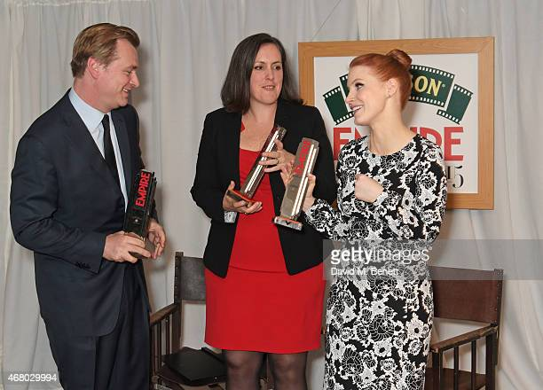 Director Christopher Nolan producer Emma Thomas and actress Jessica Chastain accepting on behalf of Best Film winner 'Interstellar' pose in the...