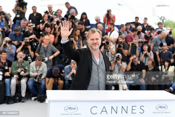 Director Christopher Nolan waves as he attends the Rendezvous With Christopher Nolan photocall during the 71st annual Cannes Film Festival at Palais...