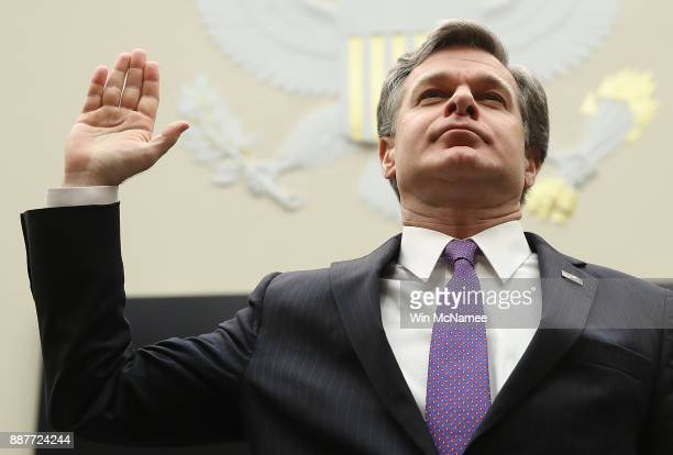 Director Christopher Wray is sworn in prior to testifying before the House Judiciary Committee December 7 2017 in Washington DC The committee hearing...