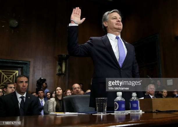Director Christopher Wray is sworn in prior to testimony before the Senate Judiciary Committee July 23 2019 in Washington DC Wray testified on the...