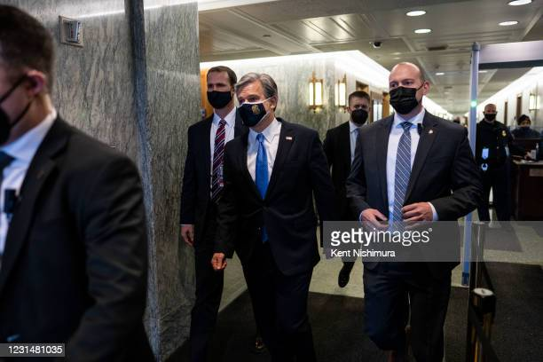Director Christopher Wray leaves Capitol Hill after speaking at a Senate Judiciary Committee hearing on Tuesday, March 2, 2021 in Washington, DC. In...