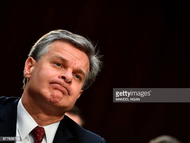 FBI Director Christopher Wray looks on as he testifies before the Senate Judiciary Committee on Examining the Inspector General's First Report on...