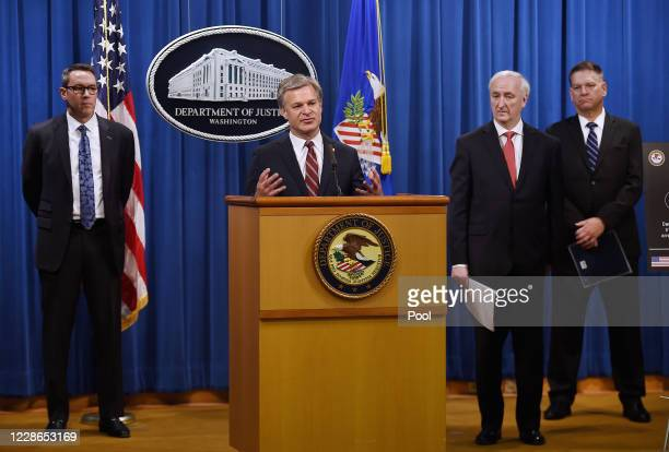 Director Christopher Wray speaks as Deputy Attorney General Jeffrey A Rosen Drug Enforcement Agency acting Administrator Timothy Shea and Immigration...