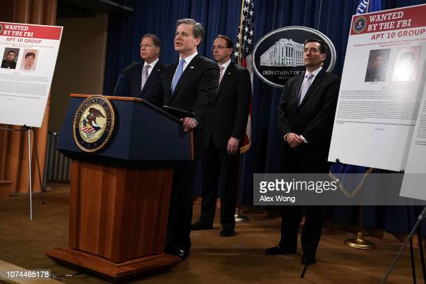 Director Christopher Wray speaks as US Attorney for the Southern District of New York Geoffrey Berman US Deputy Attorney General Rod Rosenstein and...