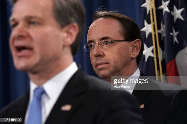 Director Christopher Wray speaks as US Deputy Attorney General Rod Rosenstein listens during a news conference to announce a Chinarelated national...
