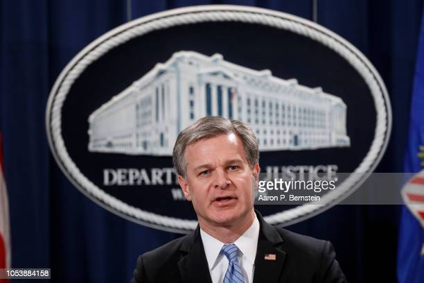 Director Christopher Wray speaks at a press conference about the apprehension of a suspect in the recent spate of mail bombings at the Department of...