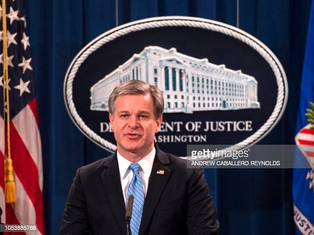 FBI Director Christopher Wray speaks during a press conference regarding the arrest of bombing suspect Cesar Sayoc in Florida at the Department of...