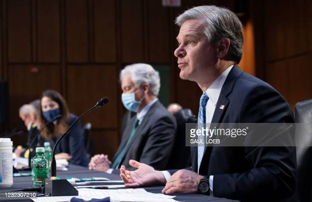 Director Christopher Wray testifies alongside CIA Director William Burns , Director Avril Haines of the Office of the Director of National...