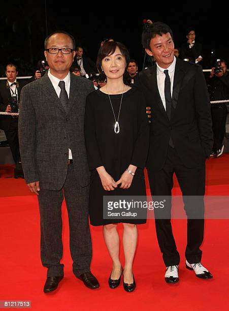 """Director Chung Mong-Hong, guest and actor Chen Chang arrive for the """"Il Divo"""" premiere at the Palais des Festivals during the 61st International..."""