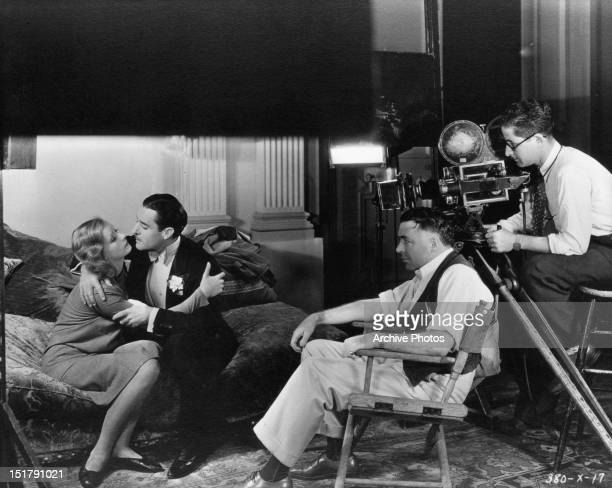 Director Clarence Brown watching seen between Greta Garbo and John Gilbert from the film 'Woman Of Affairs' 1928