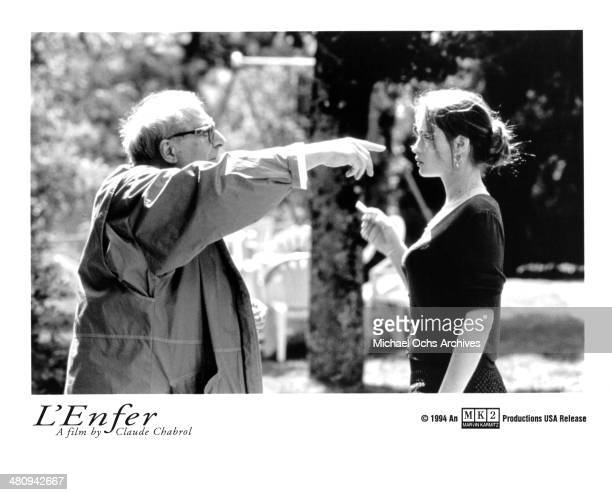 Director Claude Chabrol and actress Emmanuelle Beart on the set of the movie L'Enfer circa 1994