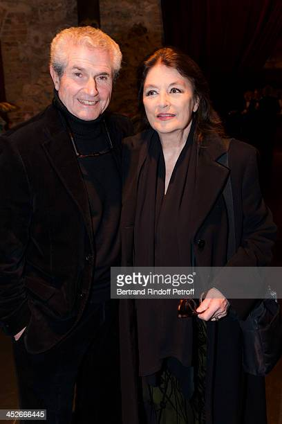 Director Claude Lelouch and actress Anouk Aimee attend the Mimi Foundation gala dinner at Musee des Arts Forains on November 30, 2013 in Paris,...