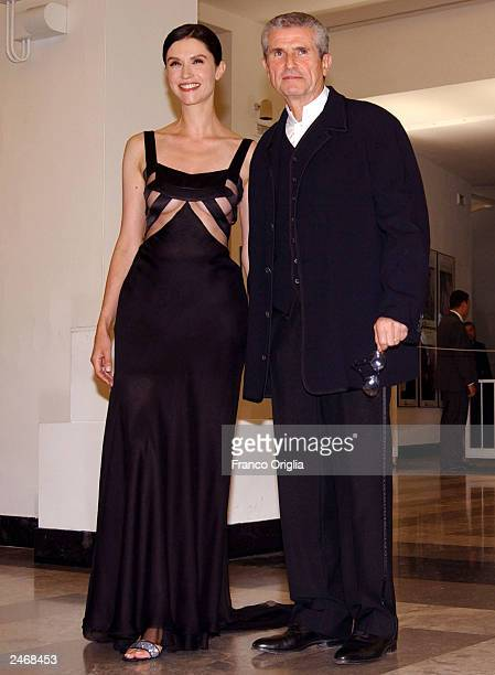 Director Claude Lelouch and his wife actress Alessandra Martinez attend the Golden Lion Award ceremony at the 60th Venice Film Festival September 6,...