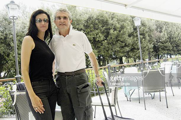 Director Claude Lelouch poses with his wife, Italian actress Alessandra Martinez, at the Hotel des Bains at Venice Film Festival on August 29, 2003...