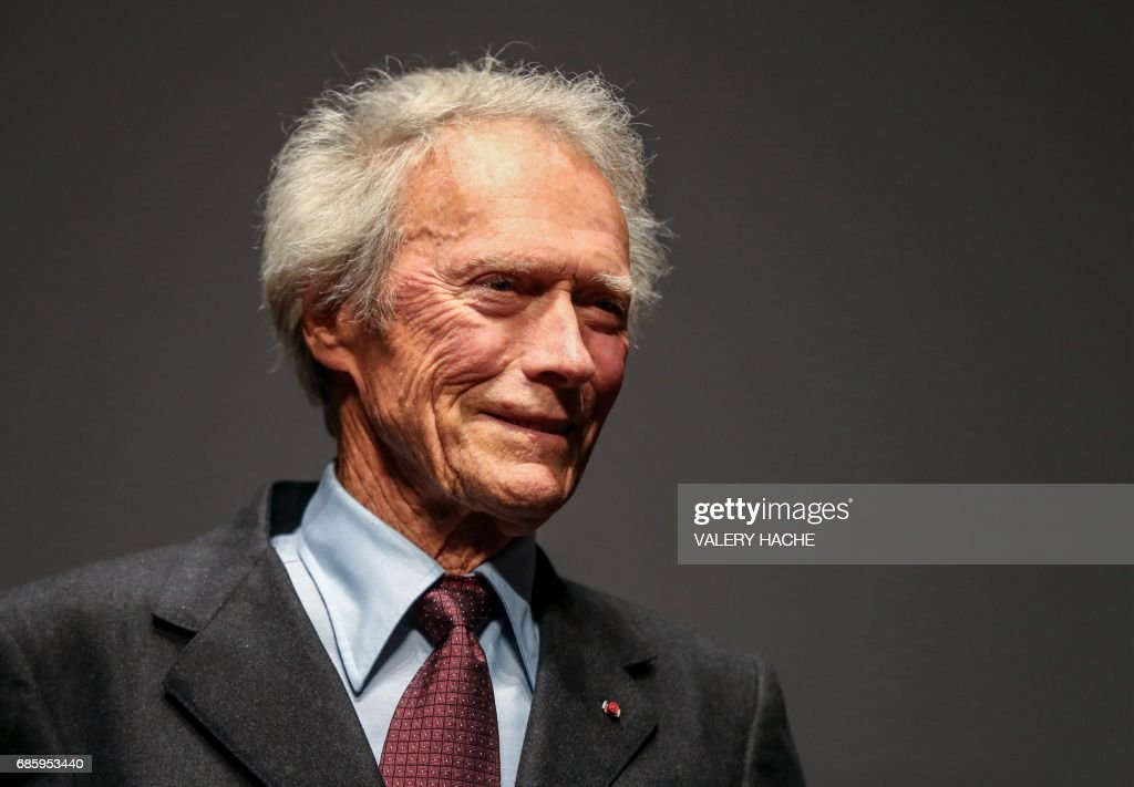 TOPSHOT - US director Clint Eastwood acknowledges applause on stage on May 20, 2017 during the presentation of the 4K remaster of his 1992 film 'Unforgiven' at the 70th edition of the Cannes Film Festival in Cannes, southern France. / AFP PHOTO / Valery HACHE