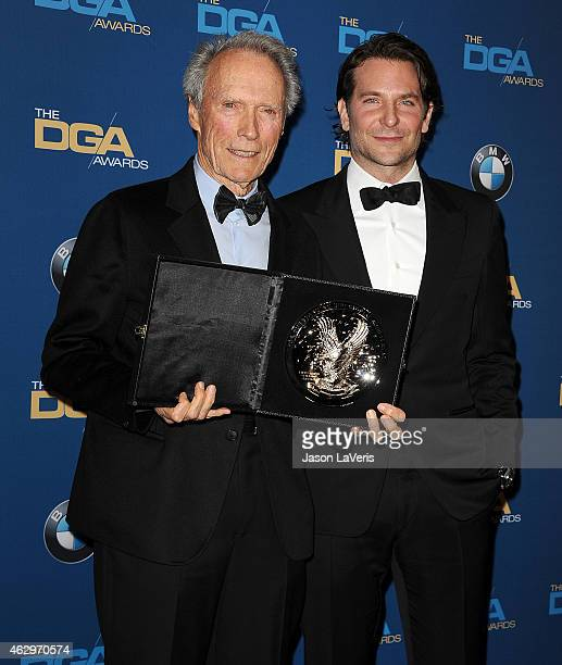 Director Clint Eastwood and actor Bradley Cooper pose in the press room at the 67th annual Directors Guild of America Awards at the Hyatt Regency...