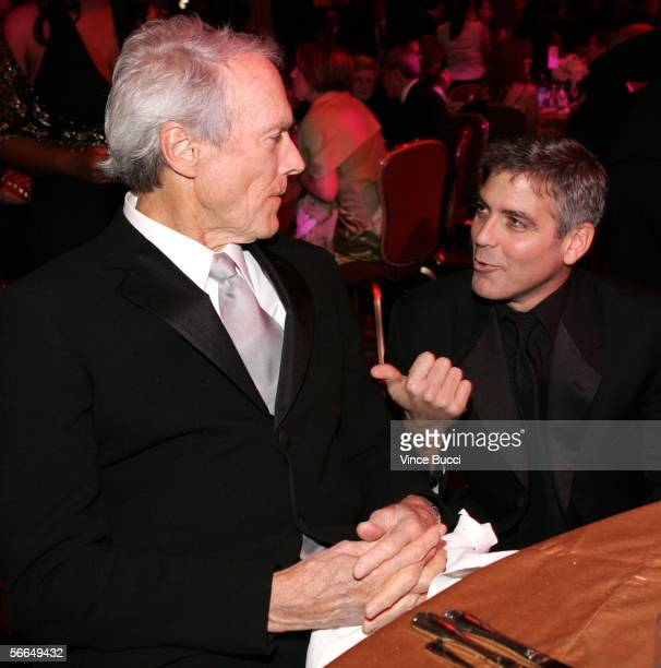 Director Clint Eastwood and actor George Clooney are seen in the audience during the 2006 Producers Guild awards held at the Universal Hilton on...